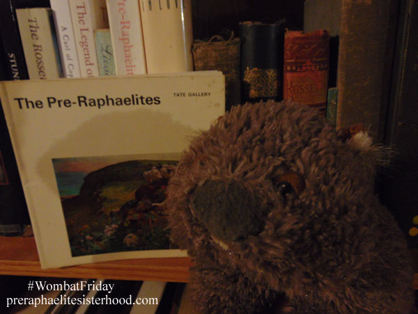 Our hero the wombat with a somewhat tattered copy of The Pre-Raphaelites, a 1966 edition of The Tate Gallery Little Book series.